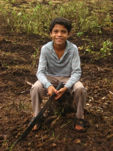 Marcelo, 10 years old, taking a break after working all morning clearing the milpa